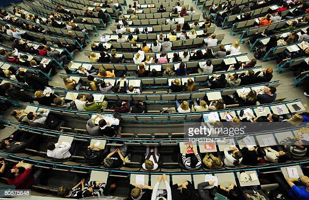 New students sit and wait to be welcomed in one of the lecture halls of the Johannes Gutenberg University in Mainz western Germany on April 9 2008...