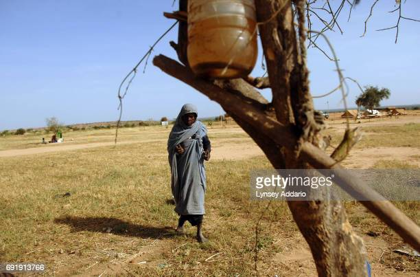 New Sudanese refugees gather under a tree after fleeing their village about 10 days prior and arriving in Gaga camp in Chad October 21 2006 The...