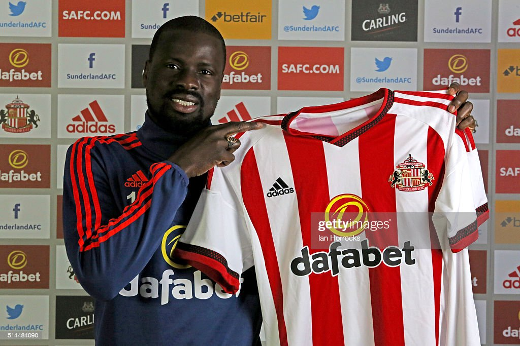 New Sunderland signing Emmanuel Eboue is pictured with a club shirt at the Academy of Light on March 09, 2016 in Sunderland, England.