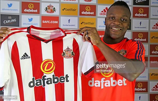 New Sunderland signing Lamine Kone holds a Sunderland top at The Academy of Light on January 27 2016 in Sunderland England