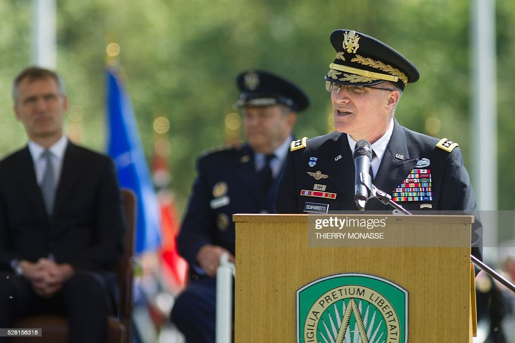 New Supreme Allied Commander Europe (SACEUR) General Curtis Mike Scaparrotti (front) give a speech in front of the NATO Secretary general Jens Stoltenberg (L) and the outgoing Supreme Allied Commander Europe (SACEUR) Philip Mark Breedlove (R) on May 4, 2016, during the change of command ceremony for NATOs Supreme Allied Commander Europe (SACEUR) at Supreme Headquarters Allied Powers Europe (SHAPE), in Mons. / AFP / Thierry Monasse