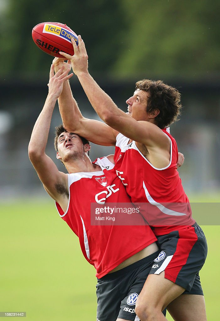 New Swans signing Kurt Tippett (R) competes during a Sydney Swans AFL training session at Moore Park on December 12, 2012 in Sydney, Australia.