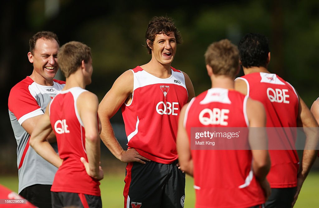 New Swans signing Kurt Tippett (C) laughs with team mates during a Sydney Swans AFL training session at Moore Park on December 12, 2012 in Sydney, Australia.