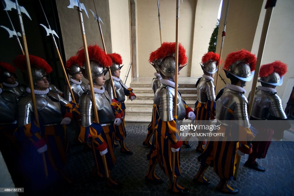 New Swiss Guard recruits walk to attend a swearing-in ceremony in San Damaso square at the Vatican on May 6, 2014. 35 new recruits sworn-in on the anniversary of the sack of Rome when they protected Pope Clement VII hideout at castel Sant' Angelo on May 6, 1527. AFP PHOTO/ Filippo MONTEFORTE