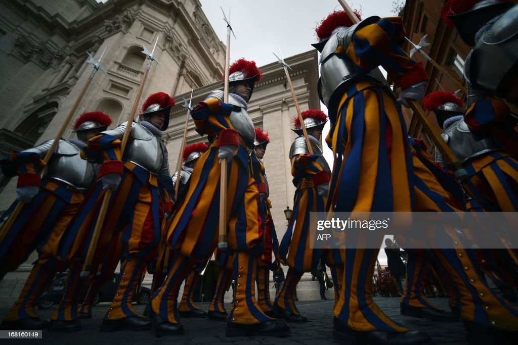 New Swiss Guard recruits walk to attend a swearing-in ceremony on May 6, 2013 at the Paul VI hall at the Vatican. 35 new recruits sworn-in on the anniversary of the sack of Rome when they protected Pope Clement VII hideout at castel Sant' Angelo on May 6, 1527. AFP PHOTO / FILIPPO MONTEFORTE