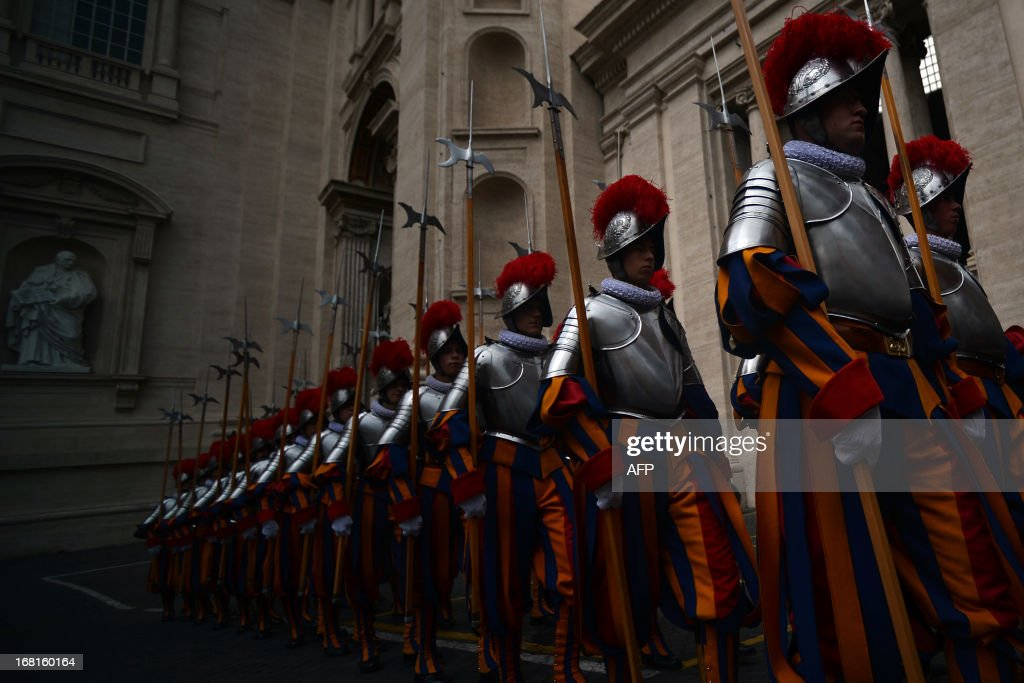 New Swiss Guard recruits walk to attend a swearing-in ceremony on May 6, 2013 at the Paul VI hall at the Vatican. 35 new recruits sworn-in on the anniversary of the sack of Rome when they protected Pope Clement VII hideout at castel Sant' Angelo on May 6, 1527.