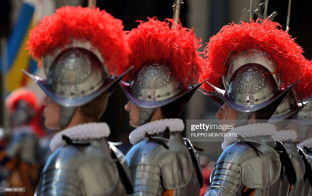 A new Swiss Guards recruit walk back after swearing-in during a ceremony in San Damaso square at the Vatican on May 6, 2014. 35 new recruits sworn-in on the anniversary of the sack of Rome when they protected Pope Clement VII hideout at castel Sant' Angelo on May 6, 1527. AFP PHOTO/ Filippo MONTEFORTE