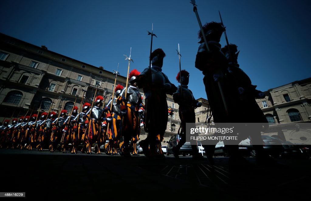 New Swiss Guards recruits walk back after swearing-in during a ceremony in San Damaso square at the Vatican on May 6, 2014. 35 new recruits sworn-in on the anniversary of the sack of Rome when they protected Pope Clement VII hideout at castel Sant' Angelo on May 6, 1527. AFP PHOTO/ Filippo MONTEFORTE
