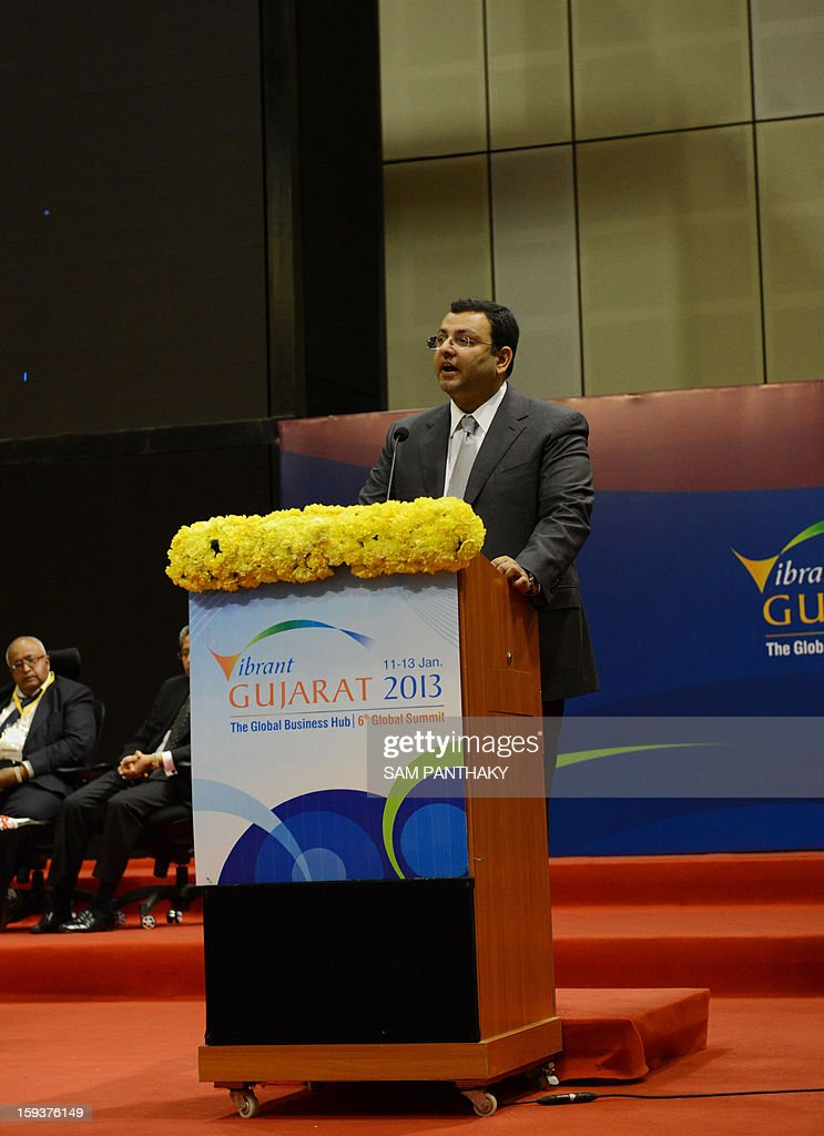 New Tata Group Chairman Cyrus Mistry (C) delivers a public address during the Velidictory function of the Vibrant Gujarat 2013 6th Global Summit at Mahatma Mandir in Gandhinagar, some 30 kms from Ahmedabad on January 12, 2013. The summit was inaugurated by Gujarat Chief Minister, Narendra Modi yesterday and the two day summit is attended by a wide range of national and international corporate representatives. AFP PHOTO / Sam PANTHAKY