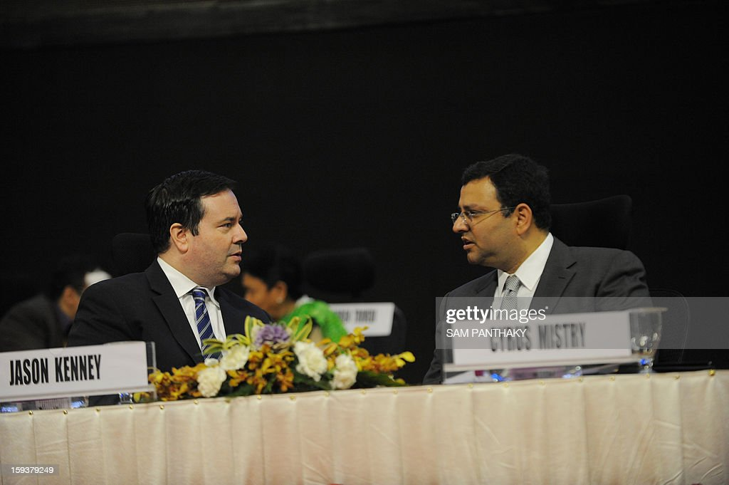 New Tata Group Chairman Cyrus Mistry (R) speaks with Canadian Immigration Minister Jason Kenney during the Velidictory function of the Vibrant Gujarat 2013 6th Global Summit at Mahatma Mandir in Gandhinagar, some 30 kms from Ahmedabad on January 12, 2013. The summit was inaugurated by Gujarat Chief Minister, Narendra Modi yesterday and the two day summit is attended by a wide range of national and international corporate representatives. AFP PHOTO / Sam PANTHAKY