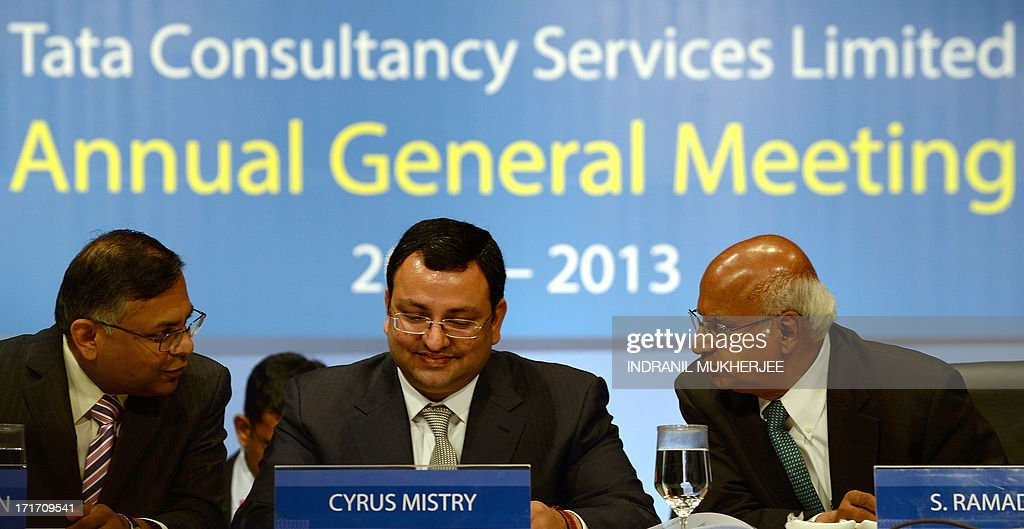 New Tata Group chairman, Cyrus Mistry (C), Tata Consultancy Services (TCS) chief executive N. Chandrasekaran (L) and non-executive vice chairman S. Ramadorai go over a report prior to the start of the 9th Annual General Meeting of Tata Consultancy Services in Mumbai on June 28, 2013. India's biggest IT outsourcing firm, Tata Consultancy Services, popularly known as TCS and part of the steel-to-tea Tata conglomerate, counts blue-chip companies such as British Airways, Microsoft and Sony among its main clients. AFP PHOTO / INDRANIL MUKHERJEE