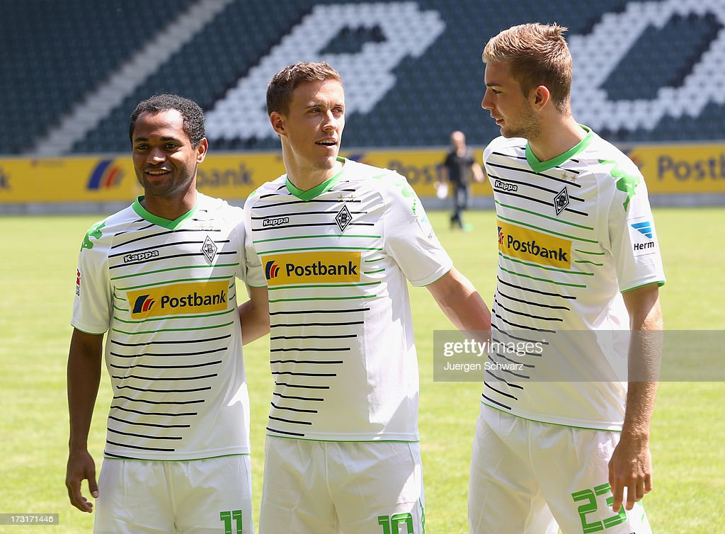 New team members Raffael, <a gi-track='captionPersonalityLinkClicked' href=/galleries/search?phrase=Max+Kruse&family=editorial&specificpeople=3945507 ng-click='$event.stopPropagation()'>Max Kruse</a> and <a gi-track='captionPersonalityLinkClicked' href=/galleries/search?phrase=Christoph+Kramer&family=editorial&specificpeople=5588926 ng-click='$event.stopPropagation()'>Christoph Kramer</a> pose during the team presentation of Borussia Moenchengladbach at on July 9, 2013 in Moenchengladbach, Germany.