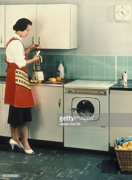 New technology in the kitchen A German housewife with a washing machine and a blender around 1958