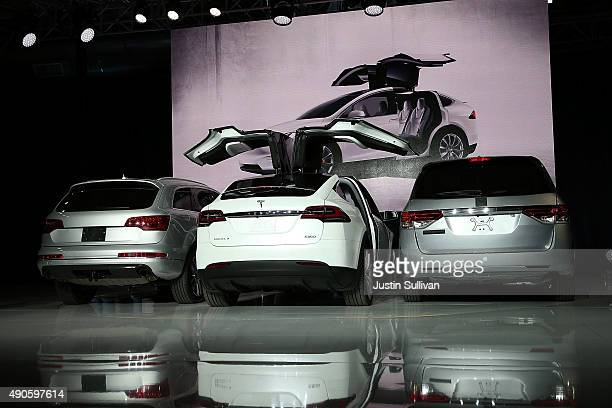 A new Tesla Model X Crossover SUV demonstrates its falcon wing doors during a launch event on September 29 2015 in Fremont California After several...
