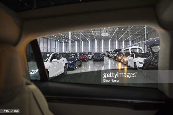 New Tesla Model X sports utility vehicles and Tesla Model S automobiles stand following assembly for the European market at the Tesla Motors Inc...