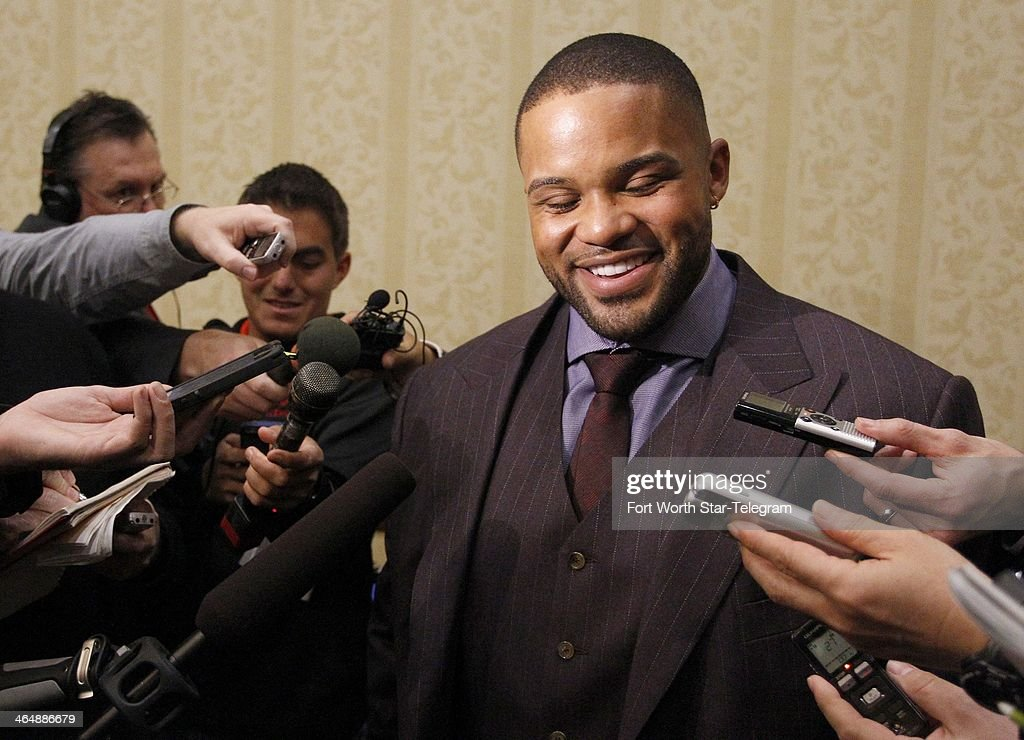 New Texas Rangers infielder Prince Fielder reacts to questions from the media in Grapevine, Texas, Friday, Jan. 24, 2014.