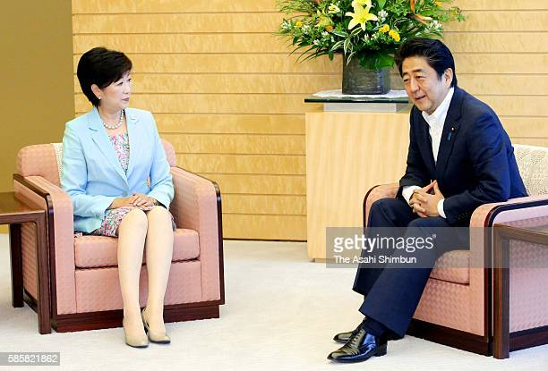 New Tokyo Metropolitan Governor Yuriko Koike and Japanese Prime Minister Shinzo Abe talk during their meeting at the Prime Minister's official...