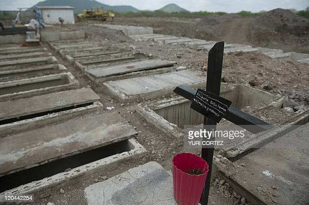 New tombs are being dug in at the 'Humaya Gardens' cementery on July 13 2011 in Culiacan Sinaloa state Mexico In a private cemetery in Sinaloa the...