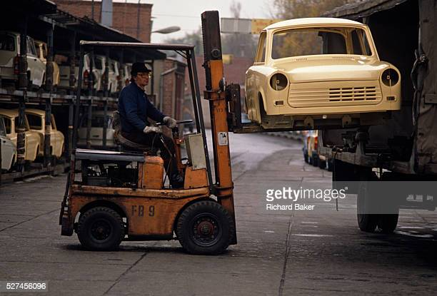 A new Trabant car shell is lifted by forklift from a truck at the East German auto maker VEB Sachsenring Automobilwerke Zwickau in Zwickau Saxony A...