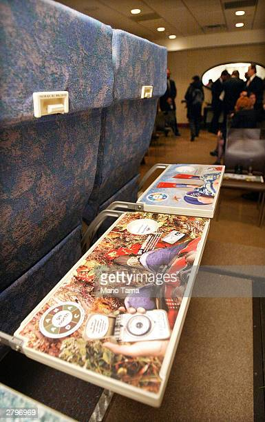 New tray table advertising by SkyMedia to be installed on America West Airlines planes are seen December 9 2003 in New York City MercedesBenz Bank of...