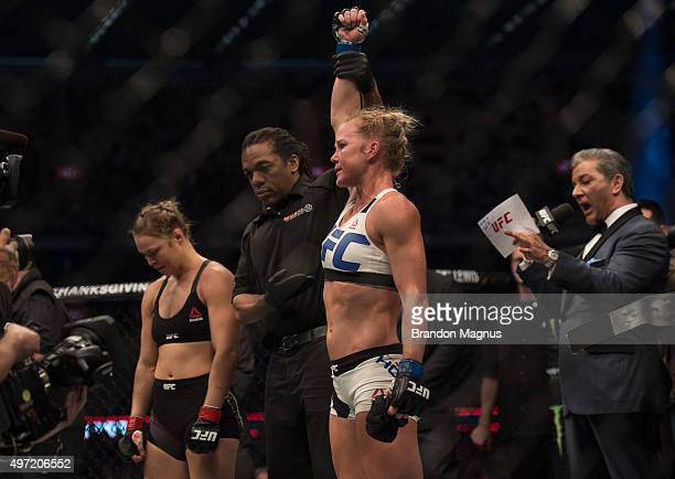 New UFC women's bantamweight champion Holly Holm of the United States celebrates her victory over Ronda Rousey of the United States during the UFC...