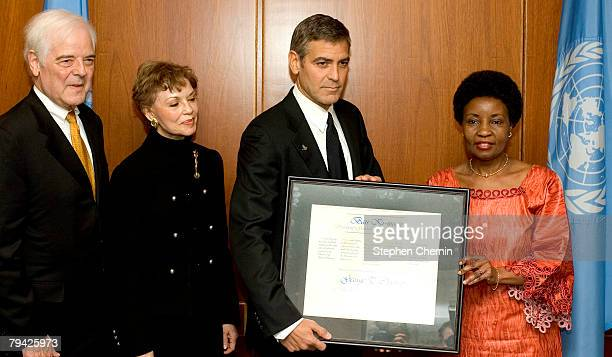 New UN Messenger of Peace George Clooney receives a certificate designating him Messenger of Peace from Deputy ScretaryGeneral Dr AshaRose Migiro as...