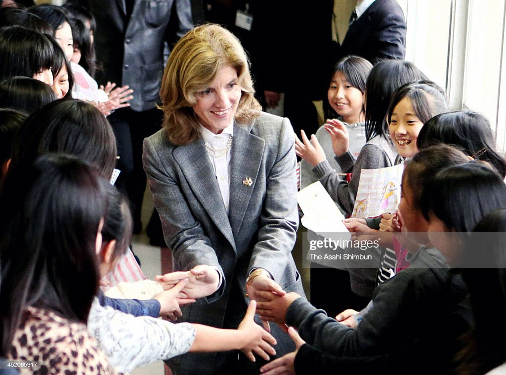 New U.S. Ambassador to Japan Caroline Kennedy is welcomed by the school pupils of Mangokuura Elementary School, where American Taylor Anderson had taught English until she was washed away by the tsunami, during her visit to Miyagi on November 25, 2013 in Ishinomaki, Miyagi, Japan. Kennedy is on two days visit to the earthquake and tsunami devastated Miyagi prefecture.