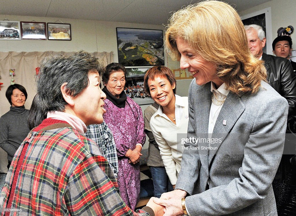 New U.S. Ambassador to Japan <a gi-track='captionPersonalityLinkClicked' href=/galleries/search?phrase=Caroline+Kennedy&family=editorial&specificpeople=93208 ng-click='$event.stopPropagation()'>Caroline Kennedy</a> shakes hands with an evacuee at a temporary housing during her visit to Miyagi on November 25, 2013 in Minamisanriku, Miyagi, Japan. Kennedy is on two days visit to the earthquake and tsunami devastated Miyagi prefecture.