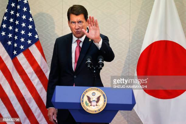 New US Ambassador to Japan William F Hagerty IV waves to the media during a press conference upon his arrival at Narita International Airport in...