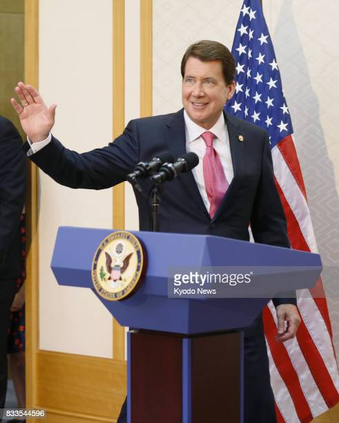 New US Ambassador to Japan William Hagerty a businessman close to US President Donald Trump waves to reporters before speaking at a press conference...