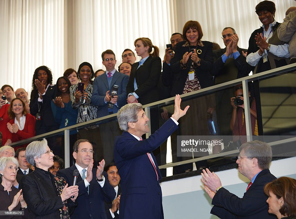 New US Secretary of State John Kerry greets State Department employees upon arrival at the State Department on February 4, 2013 in Washington, DC. Kerry, the former head of the Senate Foreign Relations Committee, replaced Hillary Clinton on February 1. AFP PHOTO/Mandel NGAN