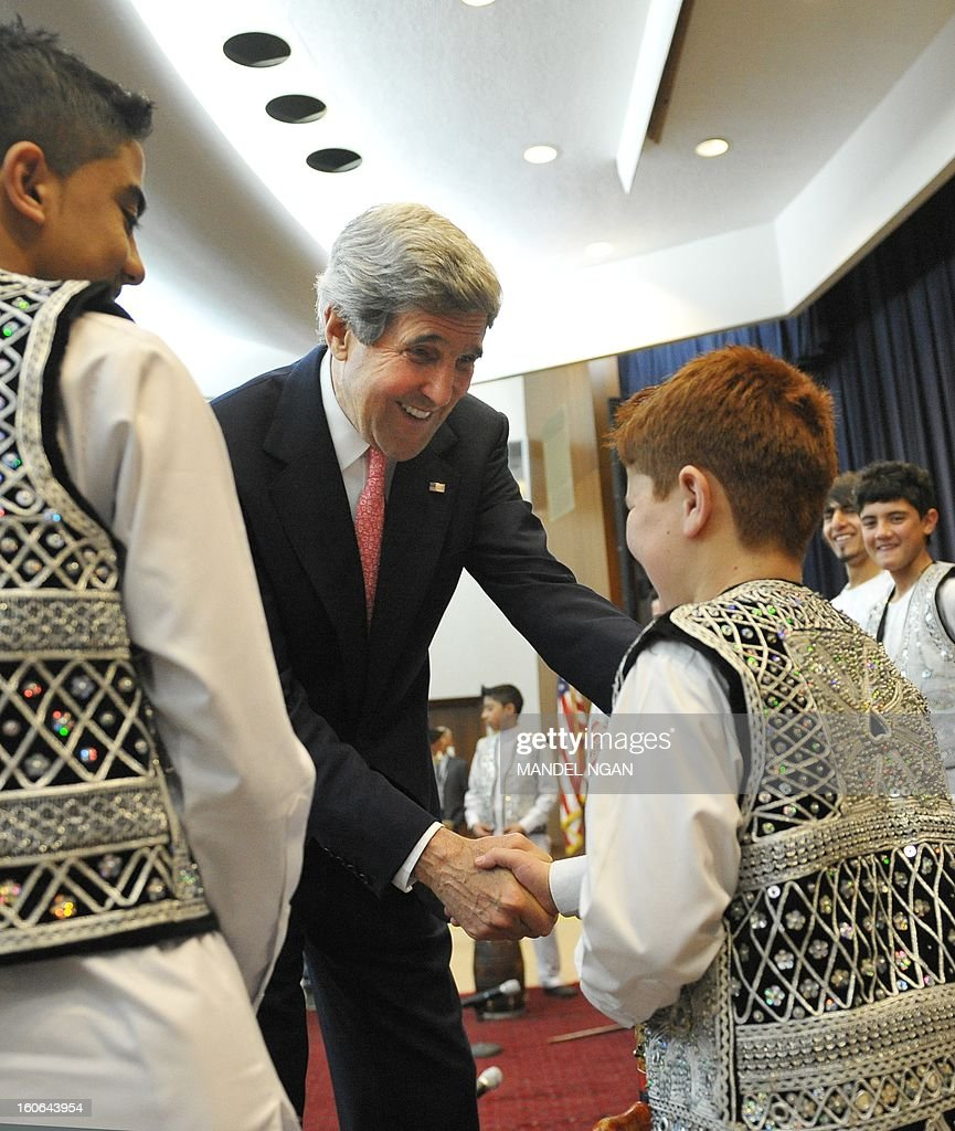New US Secretary of State John Kerry shakes hands with a young muscian from the Afghanistan National Institute of Music after watching them perform a piece in the Dean Aceson Auditorium on February 4, 2013 in Washington, DC. Kerry, the former head of the Senate Foreign Relations Committee, replaced Hillary Clinton on February 1. AFP PHOTO/Mandel NGAN