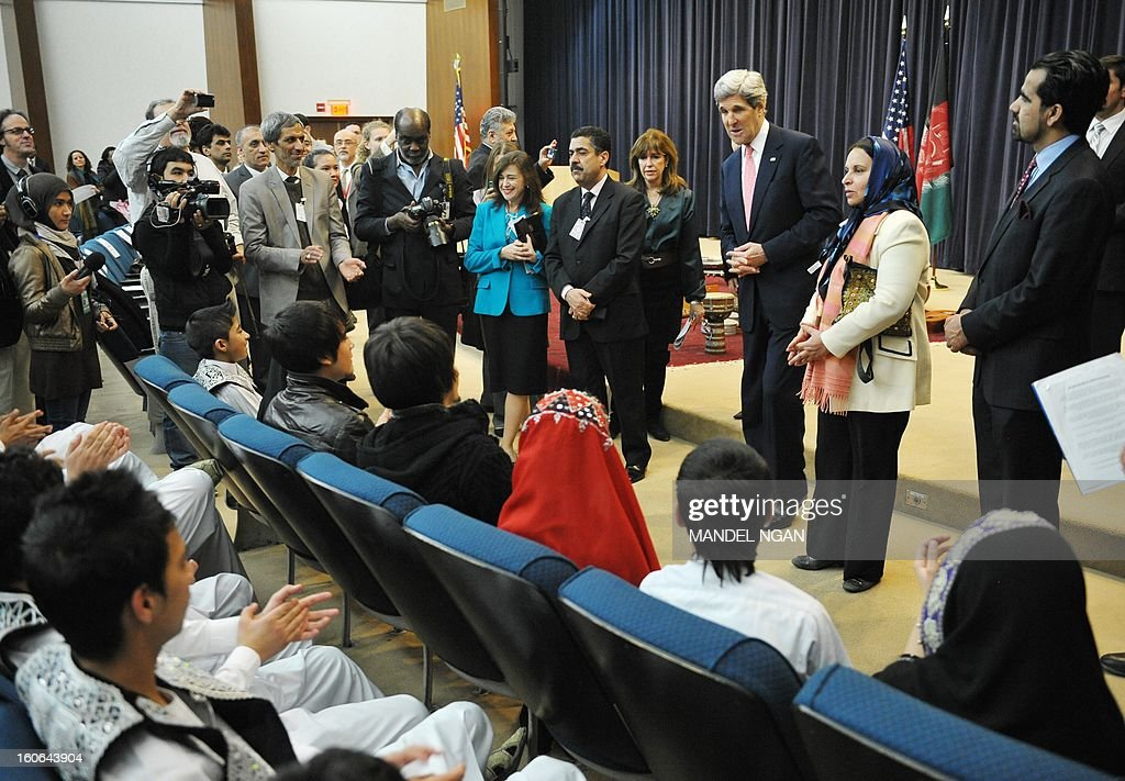 New US Secretary of State John Kerry speaks to a group of students from the Afghanistan National Institute of Music before a performance by their ensembles in the Dean Aceson Auditorium on February 4, 2013 in Washington, DC. Kerry, the former head of the Senate Foreign Relations Committee, replaced Hillary Clinton on February 1. AFP PHOTO/Mandel NGAN