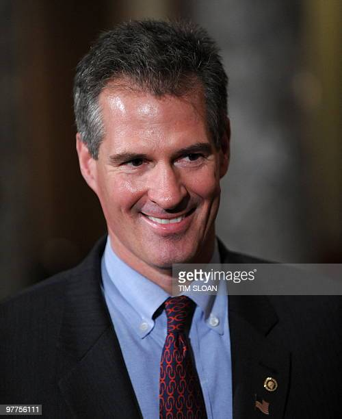 New US Senator Scott Brown talks with the press in the Old Senate Chamber after being swornin the the Seante floor by Vice President Biden on...