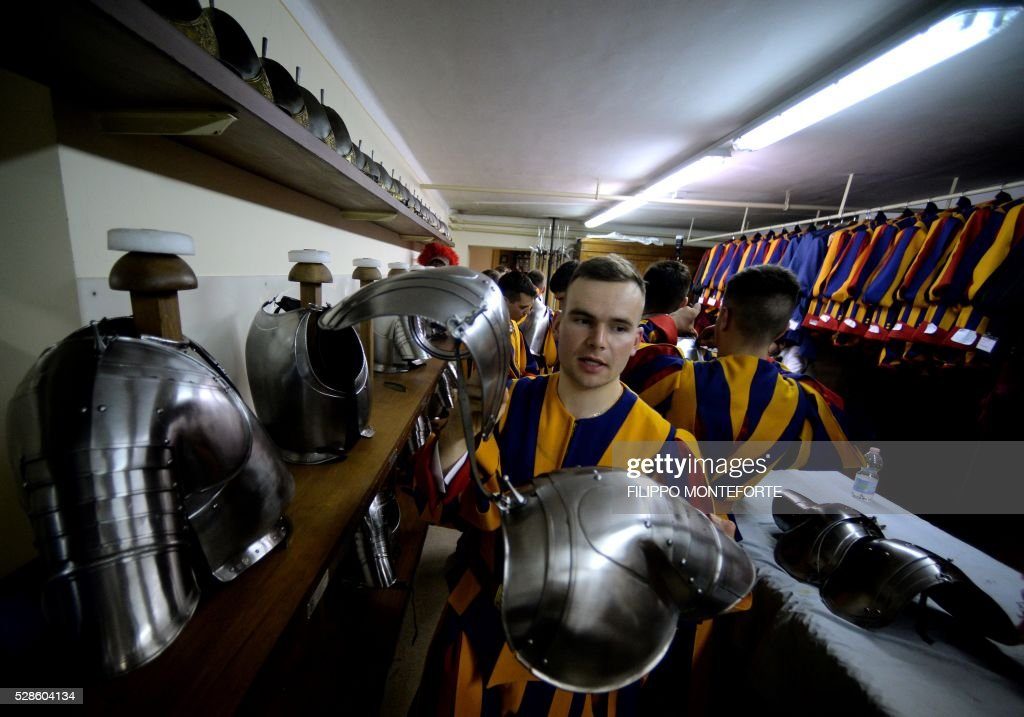 New Vatican Swiss Guards collect their uniforms prior to a swearing-in ceremony in Vatican City, on May 6, 2016. The annual swearing in ceremony for the new papal Swiss guards takes place on May 6, commemorating the 147 who died defending Pope Clement VII on the same day in 1527. / AFP / FILIPPO