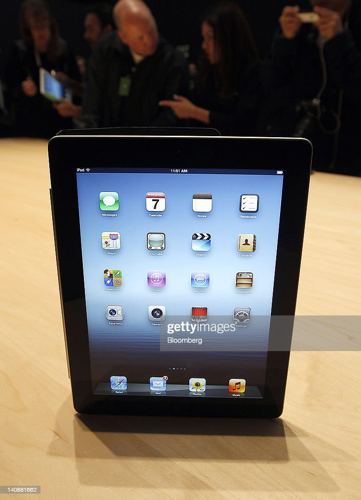 A new version of Apple Inc.'s iPad sits on display during an Apple event in San Francisco, California, U.S., on Wednesday, March 7, 2012. Apple Inc. introduced a new version of the iPad, beefing up its two-year-old mobile computer with a sharper screen to widen its lead over Amazon.com Inc., Microsoft Corp. and Google Inc. in the tablet market. Photographer: Tony Avelar/Bloomberg via Getty Images