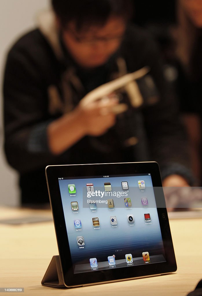 A new version of Apple Inc.'s iPad tablet computer sits on display during an Apple event in San Francisco, California, U.S., on Wednesday, March 7, 2012. Apple Inc. introduced a new version of the iPad, beefing up its two-year-old mobile computer with a sharper screen to widen its lead over Amazon.com Inc., Microsoft Corp. and Google Inc. in the tablet market. Photographer: Tony Avelar/Bloomberg via Getty Images