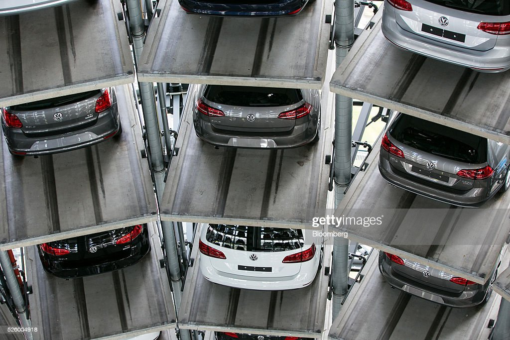 New Volkswagen AG (VW) automobiles sit in storage bays inside one of the automaker's glass delivery towers at the VW factory in Wolfsburg, Germany, on Friday, April 29, 2016. Porsche Automobil Holding SE, the investment vehicle of the billionaire family that controls VW, stuck to a goal of making acquisitions beyond the beleaguered carmaker, even as its dwindling cash on hand reduces the scope of possible transactions. Photographer: Krisztian Bocsi/Bloomberg via Getty Images