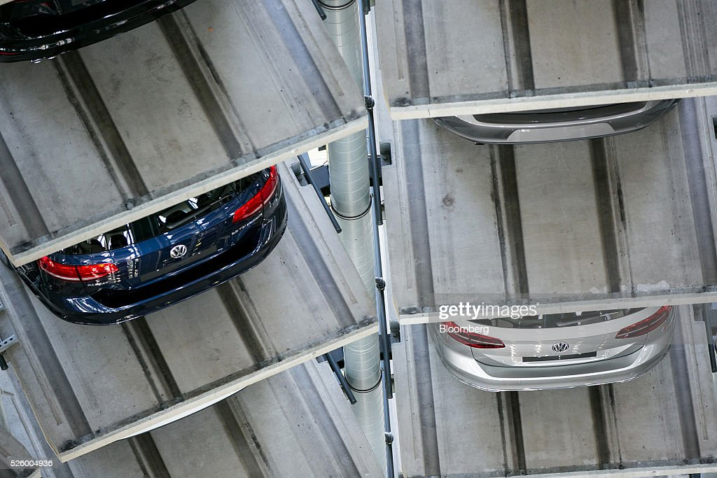 New Volkswagen AG (VW) automobiles sit in storage bays inside one of the glass delivery towers at the VW factory in Wolfsburg, Germany, on Friday, April 29, 2016. Porsche Automobil Holding SE, the investment vehicle of the billionaire family that controls VW, stuck to a goal of making acquisitions beyond the beleaguered carmaker, even as its dwindling cash on hand reduces the scope of possible transactions. Photographer: Krisztian Bocsi/Bloomberg via Getty Images