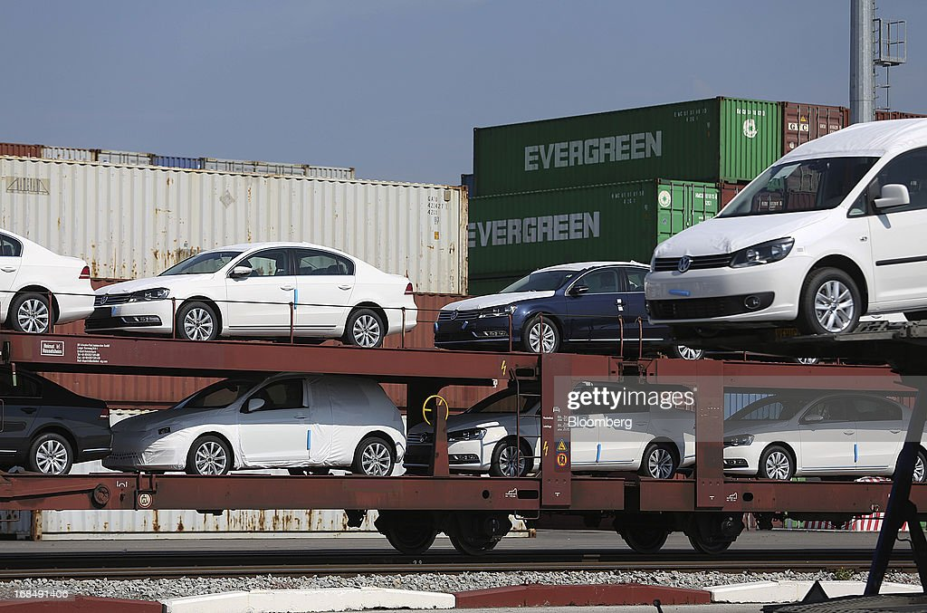 New Volkswagen AG automobiles stand on a rail transporter at the port of Koper, operated by Luka Koper d.d., in Koper, Slovenia, on Thursday, May 9, 2013. The former Yugoslav nation, mired in its second recession since 2009, will contract this year and next, according to a May 3 report by the European Commission. Photographer: Chris Ratcliffe/Bloomberg via Getty Images