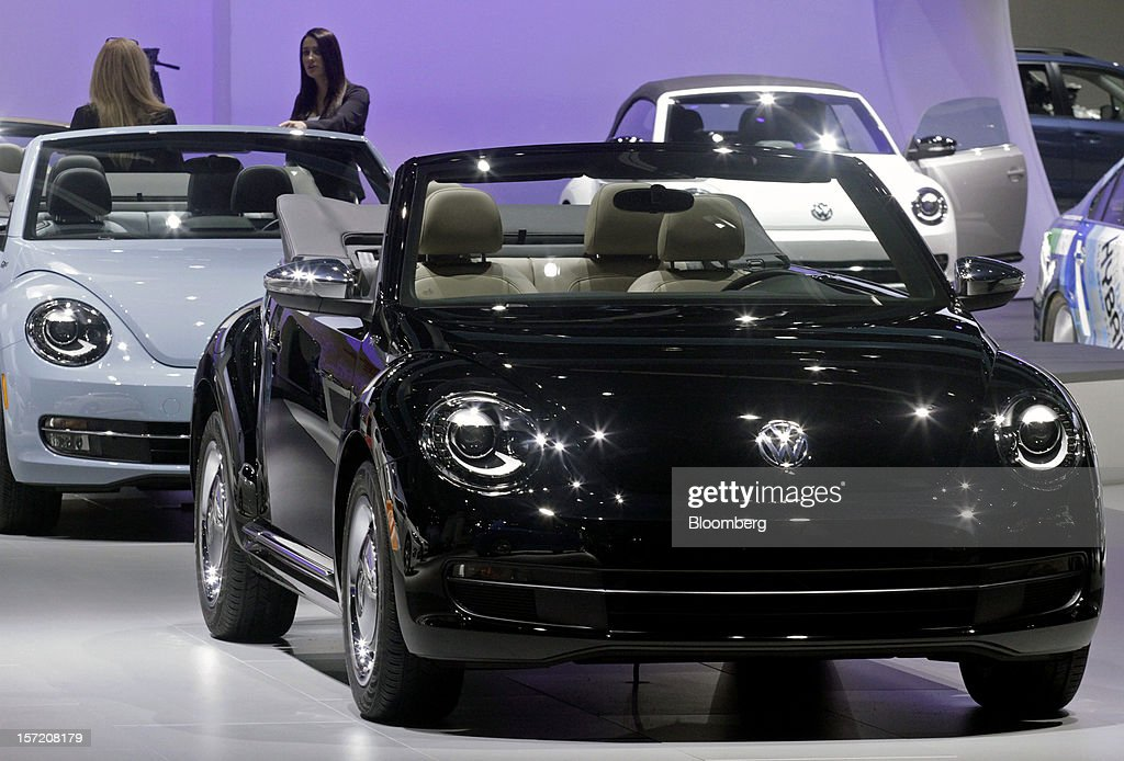 A new Volkswagen AG Beetle convertible vehicle stands on display during the LA Auto Show in Los Angeles, California, U.S., on Thursday, Nov. 29, 2012. Volkswagen, Europe's largest carmaker, has reached an agreement to extend its joint venture with China's FAW Group for another 25 years, after concluding that neither side infringed on technology patents. Photographer: Jonathan Alcorn/Bloomberg via Getty Images