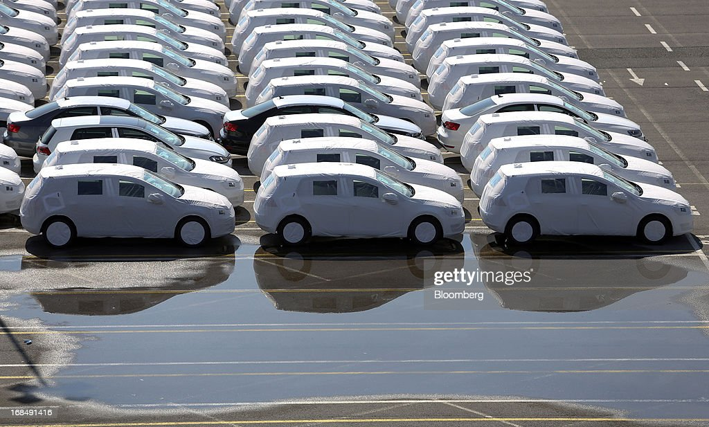New Volkswagen AG Golf automobiles stand on the dockside under protective covers at the port of Koper, operated by Luka Koper d.d., in Koper, Slovenia, on Thursday, May 9, 2013. The former Yugoslav nation, mired in its second recession since 2009, will contract this year and next, according to a May 3 report by the European Commission. Photographer: Chris Ratcliffe/Bloomberg via Getty Images