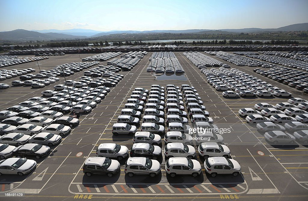 New Volkswagen AG Tiguan, below, and Skoda Auto AS Yeti, top, automobiles stand on the dockside at the port of Koper, operated by Luka Koper d.d., in Koper, Slovenia, on Thursday, May 9, 2013. The former Yugoslav nation, mired in its second recession since 2009, will contract this year and next, according to a May 3 report by the European Commission. Photographer: Chris Ratcliffe/Bloomberg via Getty Images