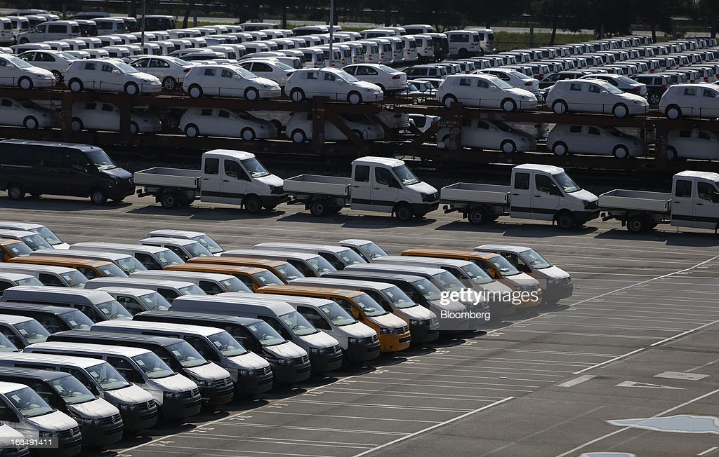 New Volkswagen AG vans, left, stand on the dockside at the port of Koper, operated by Luka Koper d.d., in Koper, Slovenia, on Thursday, May 9, 2013. The former Yugoslav nation, mired in its second recession since 2009, will contract this year and next, according to a May 3 report by the European Commission. Photographer: Chris Ratcliffe/Bloomberg via Getty Images