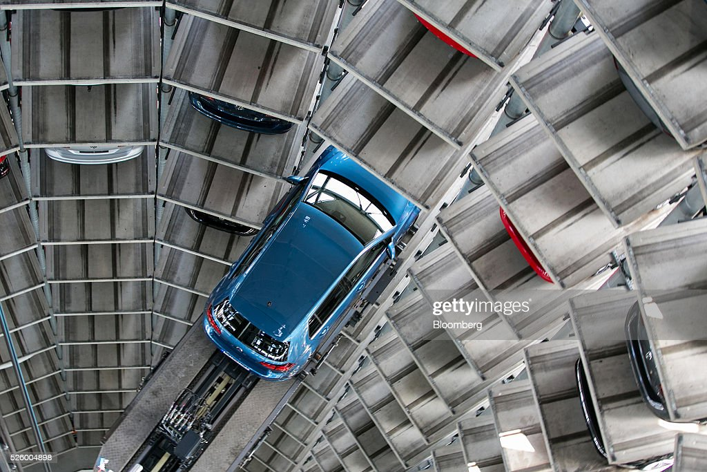 A new Volkswagen e-Golf electric automobile, produced by Volkswagen AG (VW), is guided into a storage bay inside one of the automaker's glass delivery towers at the VW factory in Wolfsburg, Germany, on Friday, April 29, 2016. Porsche Automobil Holding SE, the investment vehicle of the billionaire family that controls VW, stuck to a goal of making acquisitions beyond the beleaguered carmaker, even as its dwindling cash on hand reduces the scope of possible transactions. Photographer: Krisztian Bocsi/Bloomberg via Getty Images