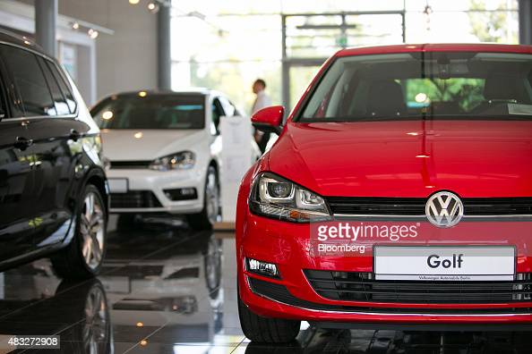 New Volkswagen Golf automobiles sit on display inside the Volkswagen AG showroom in Berlin Germany on Thursday Aug 6 2015 In Europe the longest...