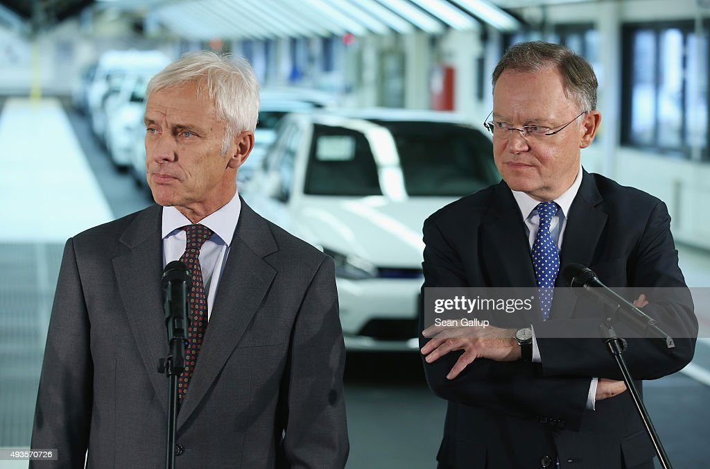 New Volkswagen Group Chairman Matthias Mueller (L) and Lower Saxony Governor <a gi-track='captionPersonalityLinkClicked' href=/galleries/search?phrase=Stephan+Weil&family=editorial&specificpeople=4683319 ng-click='$event.stopPropagation()'>Stephan Weil</a> speak to the media while standing at the assembly line of the Volkswagen factory on October 21, 2015 in Wolfsburg, Germany. The two toured the plant and met with workers as Volkswagen continues to struggle through the wake of the Volkswagen diesel emissions scandal. The company installed software that cheats during emissions test into 11 million of its diesel cars sold worldwide.