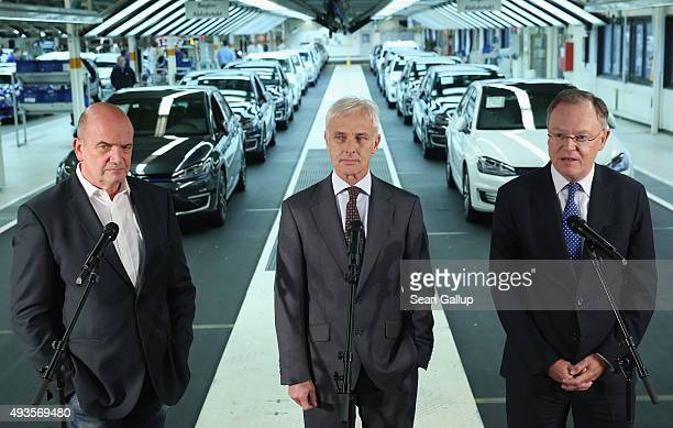 New Volkswagen Group Chairman Matthias Mueller Volkswagen Work Council head Bernd Osterloh and Lower Saxony Governor Stephan Weil speak to the media...