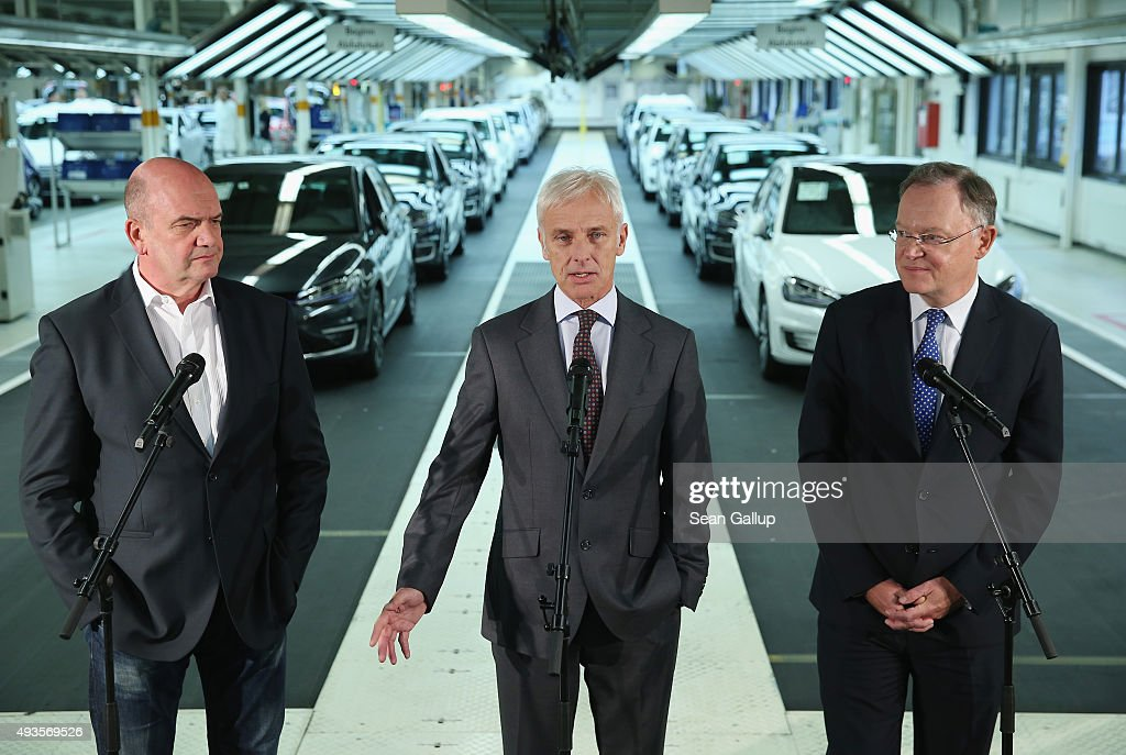 New Volkswagen Group Chairman Matthias Mueller (C), Volkswagen Work Council head Bernd Osterloh (L) and Lower Saxony Governor <a gi-track='captionPersonalityLinkClicked' href=/galleries/search?phrase=Stephan+Weil&family=editorial&specificpeople=4683319 ng-click='$event.stopPropagation()'>Stephan Weil</a> speak to the media while standing at the assembly line of the Volkswagen factory on October 21, 2015 in Wolfsburg, Germany. The three toured the plant and met with workers as Volkswagen continues to struggle through the wake of the Volkswagen diesel emissions scandal. The company installed software that cheats during emissions test into 11 million of its diesel cars sold worldwide.