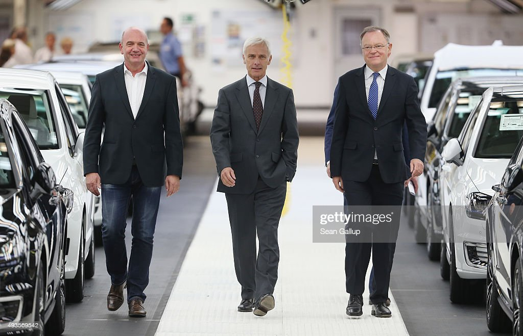 New Volkswagen Group Chairman Matthias Mueller (C), Volkswagen Work Council head Bernd Osterloh (L) and Lower Saxony Governor Stephan Weil arrive to speak to the media at the assembly line of the Volkswagen factory on October 21, 2015 in Wolfsburg, Germany. The three toured the plant and met with workers as Volkswagen continues to struggle through the wake of the Volkswagen diesel emissions scandal. The company installed software that cheats during emissions test into 11 million of its diesel cars sold worldwide.